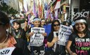 Domestic helpers rally for labour rights
